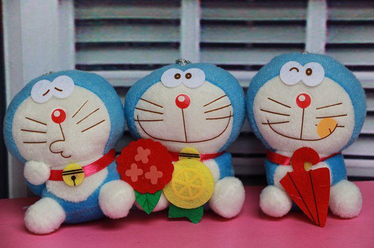 可爱卡通猫公仔机器猫毛绒玩具奶头A梦哆啦钥图提表情包包包图片