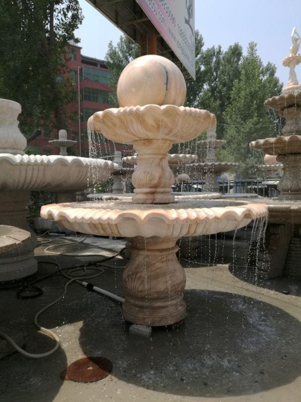 晚霞红石雕风水球喷泉流水效果实拍