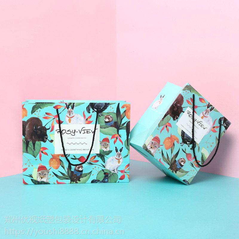 服装手提纸袋定制加工白卡纸广告袋子印刷郑州优视印刷厂