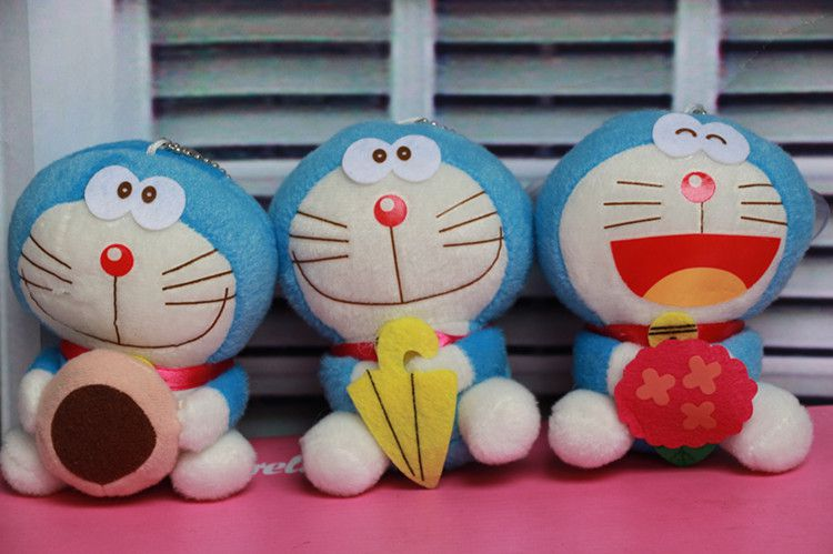 可爱卡通猫公仔机器猫毛绒玩具表情A梦婴儿钥哆啦做很生气的包包图片大全图片