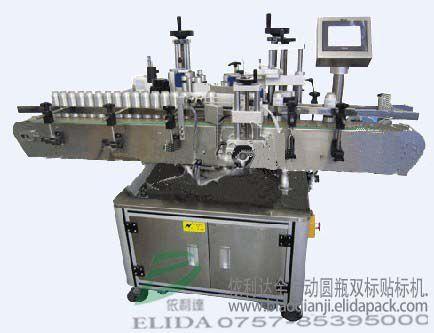 泉州晋江依利达方瓶直线式套标机|苏州常熟通州扁瓶在线式套标签机