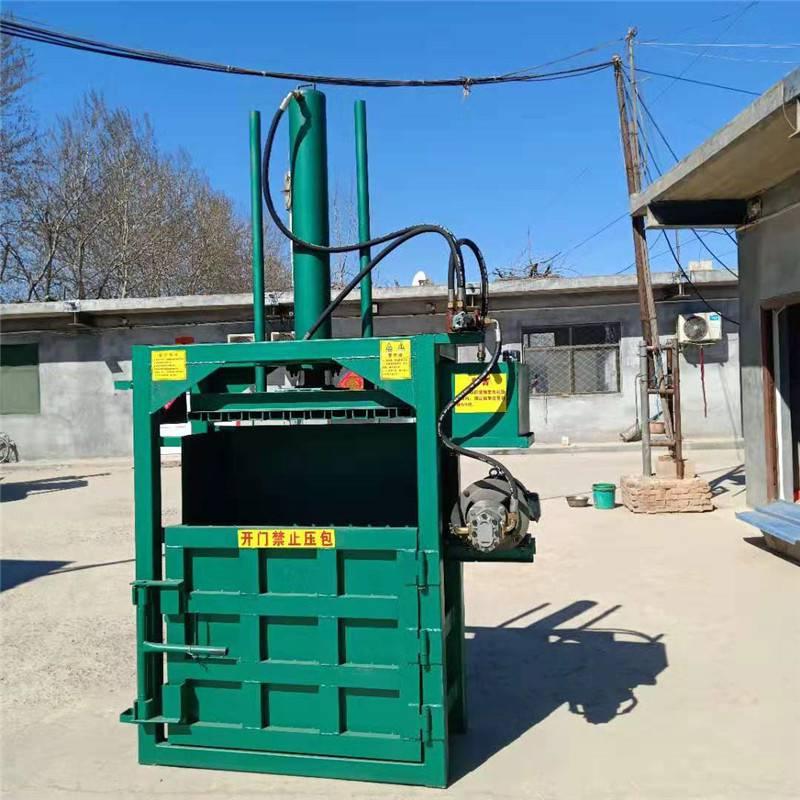 纸箱压缩打包机 富兴易拉罐废纸箱压块机 废铁废钢压包机视频
