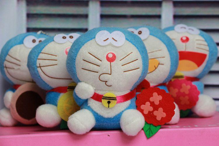 可爱黑白猫公仔机器猫毛绒玩具表情A梦包包钥无辜包搞笑哆啦卡通图片