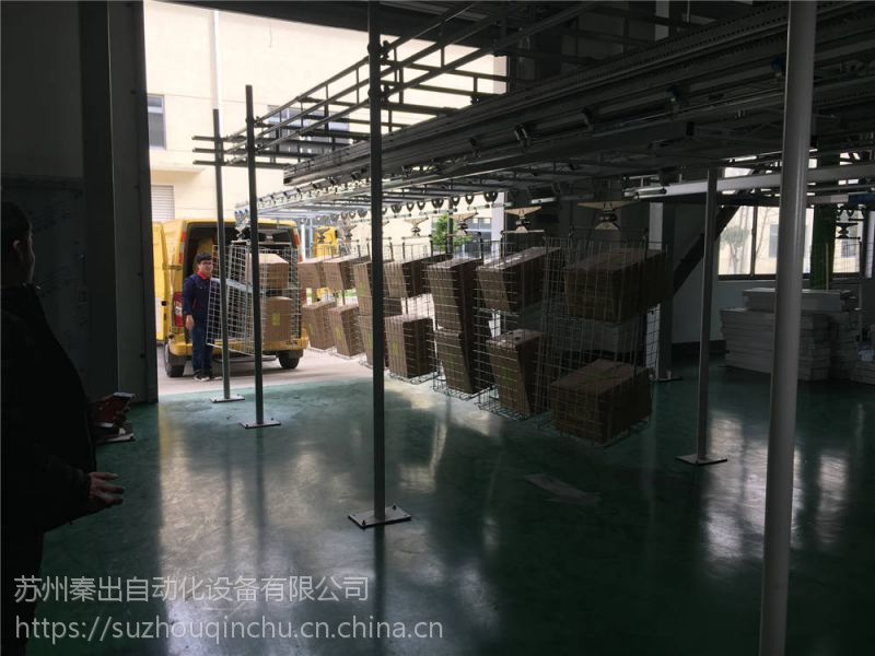 服装行业智能工厂_苏州秦出叠装仓储出库输送线自动控制系统
