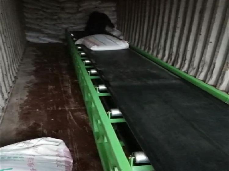 电动升降输送机 袋装物料运输机