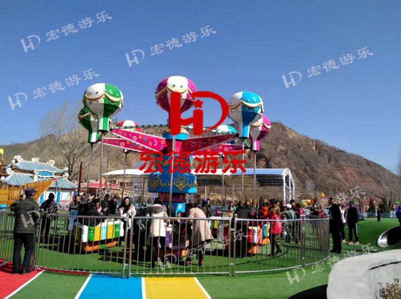 游乐园造型新颖人气旺亲子互动摇头旋转升降桑巴气球