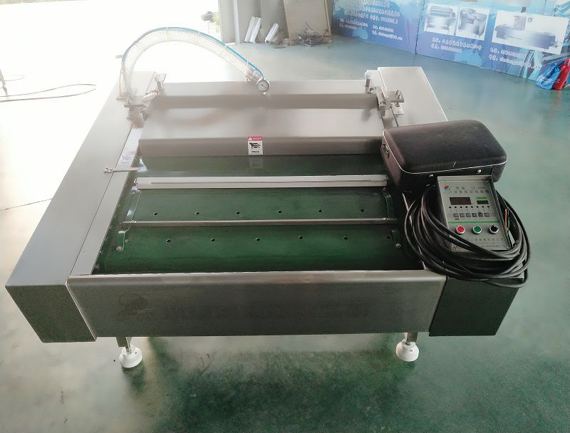 小康牌DZ-1000电脑滚动真空包装机