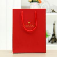 厂家直销 经典环保纸袋 婚礼手提袋 服装包装袋 礼品袋一包起发