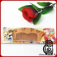 厂家直销春兆10cm卡通挂件可以加印LOGO桃木梳广东原木色木梳赠品