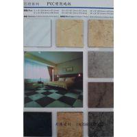 供应南充PVC片材石塑地板茶楼地毯纹石纹地板防滑耐磨吸音办公室地板