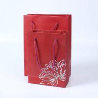 供应优质新款高档白卡纸质烫金手提袋加工订制(厂家直销)