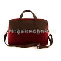 高韵箱包工厂专业生产毛毡双色搭配手提斜旅行双带行李包