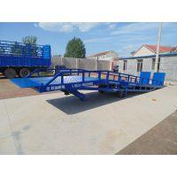 蓝色12t登车桥设计理念及升降 【龙铸机械】萧山区移动式液压式登车桥是与叉车配合使用的货物装卸