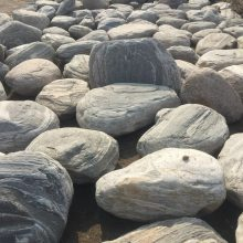 泰山石批发广东哪里有泰山石出售庭院假山案例