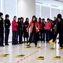 趣味脚踏实地器材pvc 木质大脚板协力竞走器 心悦趣味运动会策划方案有哪些?