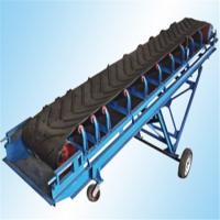 豆粨饲料输送机型号 兴亚袋装大倾角皮带输送机价格