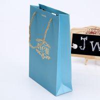 嘉伟加工供应蓝色服装购物袋 环手提纸袋定做 白卡服装礼品纸袋
