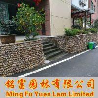 鹅卵石驳岸围边 花坛用鹅卵石驳岸 河卵石贴墙多少钱?广东河卵石