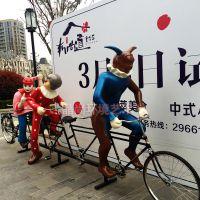 玻璃钢园林景观雕塑 大型仿真5小丑骑车表演彩绘雕像 抽象自行车人 适合房地产摆设树脂工艺品生产厂家