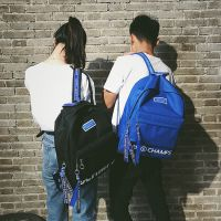 情侣书包女韩版双肩包带网兜原宿韩国高中学生帆布背包男潮