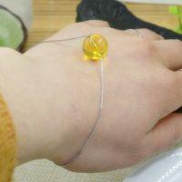 厂家直销二代蜜蜡时尚简约款10MM多米尼加变色金蓝珀圆珠手饰手链