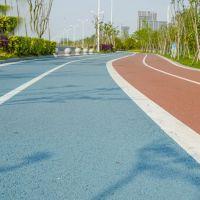 重庆市梁平县彩色透水地坪压模混凝土材料 透水混凝土增强剂 透水地坪胶结料