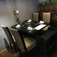田园鸳鸯火锅店电磁炉火锅桌,黑色四人大理石台面,高靠背椅子 多多乐家具家具定制