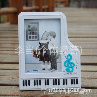 厂家直销欧式正品创意钢琴造型相框7寸摆台影楼批发儿童宝宝相架图片
