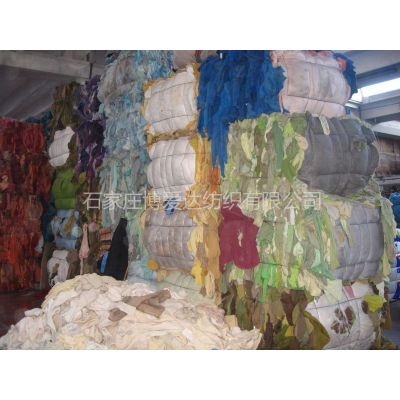 供应常年出售纺织废料(边丝、西服面料碎布、精纺布角、旧毛衣等) 直接国外进口 保证含毛量 货源稳定