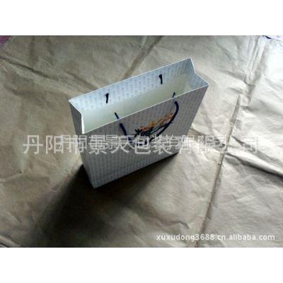 供应专业制作 凹印白卡纸服装纸袋手提袋