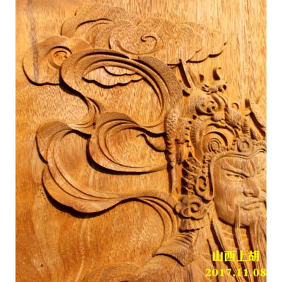 山西上胡为广东客户定制菠萝格实木大门-雕刻门神