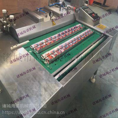 盐焗鸡块滚动式包装机 连续式链条真空设备 海诺厂家供应