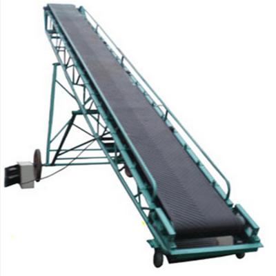 化工原料抽屉式皮带输送机 兴亚箱装物料装卸输送机图片