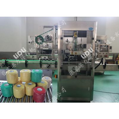 张家港力得利纱线自动套标机 灭蚊剂塑料瓶套标机