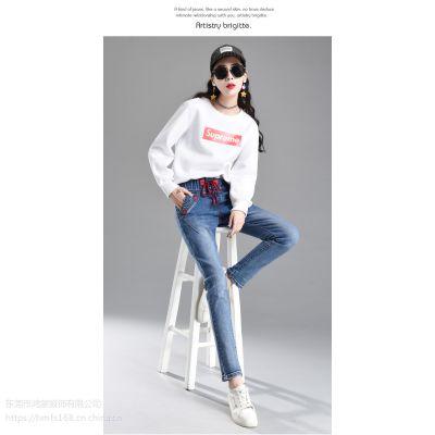 虎门服装批发厂家一手货源供应大量新款时尚韩版女装小脚牛仔裤老爹裤批发