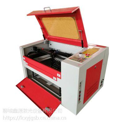 鑫源6090型亚克力广告雕刻机水晶字激光雕刻机生产厂家